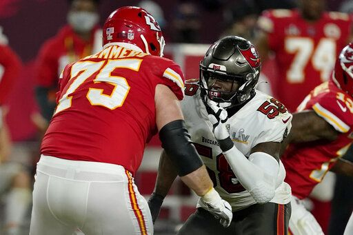 FILE - In this Sunday, Feb. 7, 2021 file photo, Tampa Bay Buccaneers outside linebacker Shaquil Barrett (58) moves in to block Kansas City Chiefs offensive tackle Mike Remmers (75) during the second half of the NFL Super Bowl 55 football game in Tampa, Fla. Applying franchise and even transition tags to players can have major ramifications on a team's present and future. That was never more of a consideration than this year, with the salary cap decreasing by, for now, $18 million. That's the first time the cap has gone down, which is due to lost revenues caused by the COVID-19 pandemic.
