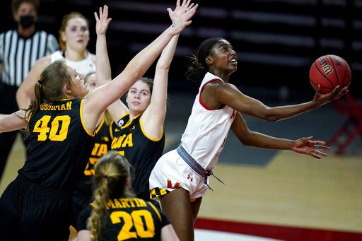 Maryland guard Diamond Miller, right, goes up for a shot against Iowa center Sharon Goodman (40), guard Kate Martin (20) and guard Lauren Jensen, center, during the second half of an NCAA college basketball game, Tuesday, Feb. 23, 2021, in College Park, Md. Maryland won 111-93.