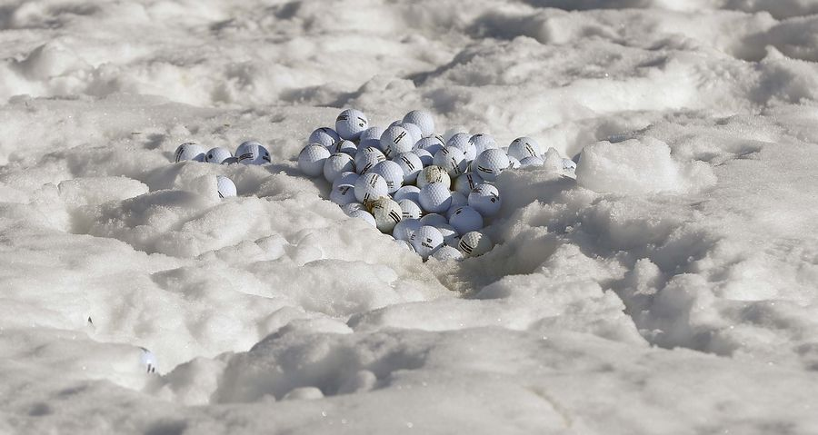 A growing pile of range balls sit in the snow at Cantigny Golf Thursday in Wheaton.