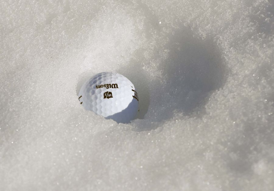 A lone range ball is lost in the snow at the Cantigny Golf Academy driving range Thursday in Wheaton.