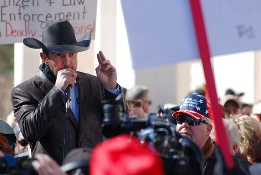 FILE - In this Friday, Jan. 31, 2020 file photo, Otero County Commissioner Couy Griffin speaks in Santa Fe, N.M., during a gun rights rally. Griffin, who founded the group 'œCowboys for Trump,'� entered the Capitol grounds in Washington on Jan. 6, 2021, then kept posting on Parler about his support for continuing the fight and told his fellow county commissioners that he planned to attend the inauguration armed.