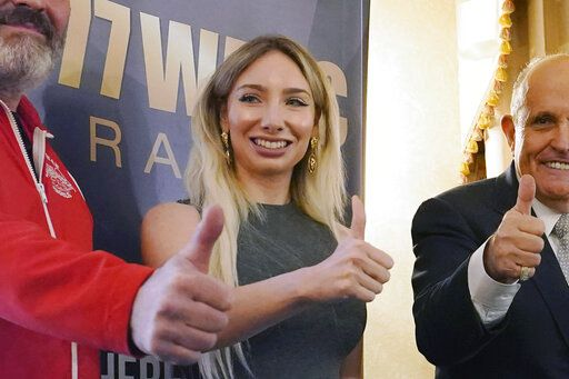 FILE - In this Wednesday, Sept. 16, 2020, file photo, Manhattan GOP chairwoman Andrea Catsimatidis poses for a photograph during a news conference at the Women's Republican Club in New York. 'œCorporate America helped rig the election,'� she retweeted after President Joe Biden's inauguration.