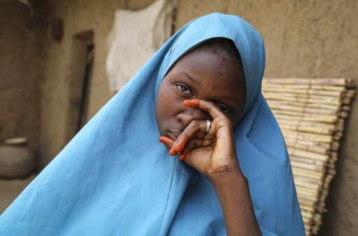 Student Masauda Umar, 20, who hid under her bed and managed to escape when gunmen abducted more than 300 girls from her boarding school on Friday, recounts her ordeal at her house in Jangebe town, Zamfara state, northern Nigeria Saturday, Feb. 27, 2021. Nigerian police and the military have begun joint operations to rescue the more than 300 girls who were kidnapped from the Government Girls Junior Secondary School, according to a police spokesman.