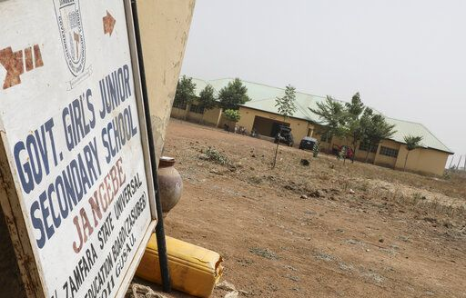 A sign pointos to the Government Girls Junior Secondary School from where more than 300 girls were abducted on Friday by gunmen, in Jangebe town, Zamfara state, northern Nigeria Saturday, Feb. 27, 2021. Nigerian police and the military have begun joint operations to rescue the more than 300 girls who were kidnapped from the boarding school, according to a police spokesman.