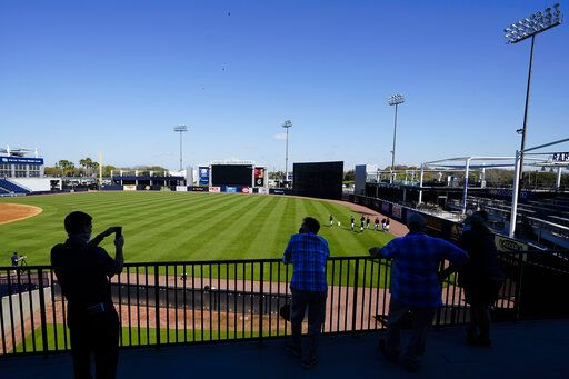 Members of the media watch the New York Yankees during a spring training baseball workout Tuesday, Feb. 23, 2021, in Tampa, Fla.