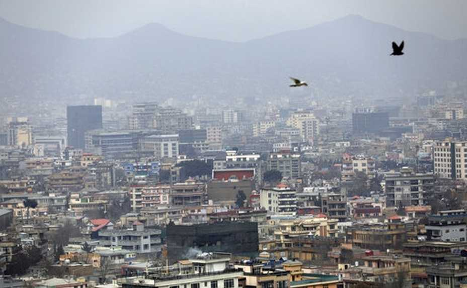 FILE - In this Feb. 1, 2021 file photo, birds flyover the city of Kabul, Afghanistan. The United States wasted billions of dollars in war-torn Afghanistan on buildings and vehicles that were either abandoned or destroyed, according to a report released Monday, March 1, 2021, by the Special Inspector General for Afghanistan Reconstruction, a U.S. government watchdog. (AP Photo/Rahmat Gul, File)