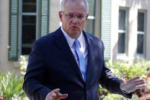 Australia's Prime Minister Scott Morrison speaks to the media in Sydney, Monday, March 1, 2021. Morrison stood by an unnamed Cabinet minister against calls for him to step down from office over an allegation that he raped a 16-year-old girl more than 30 years ago. (AP Photo/Rick Rycroft)