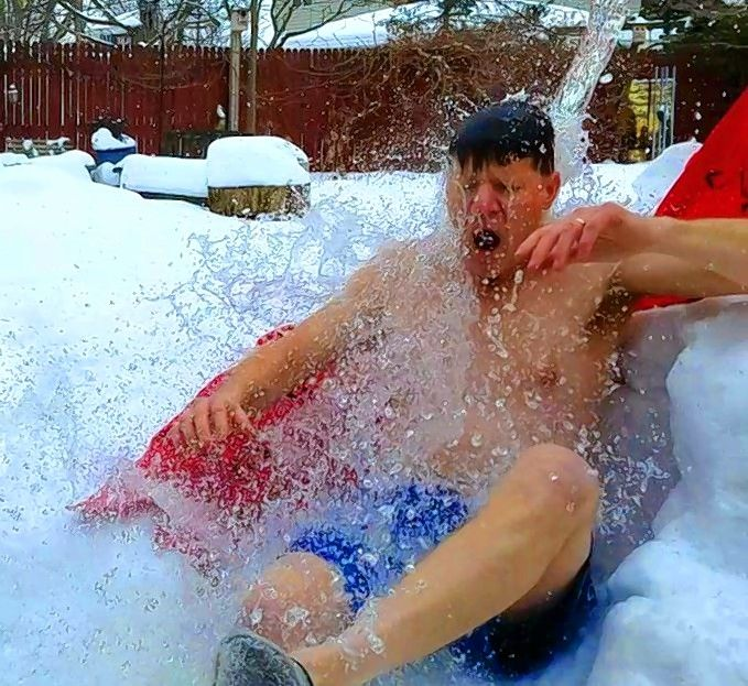 John Pottebaum of Wheaton takes a slushy ride for the Law Enforcement Torch Run Polar Plunge. This year's event, which is virtual, takes place through March 14.