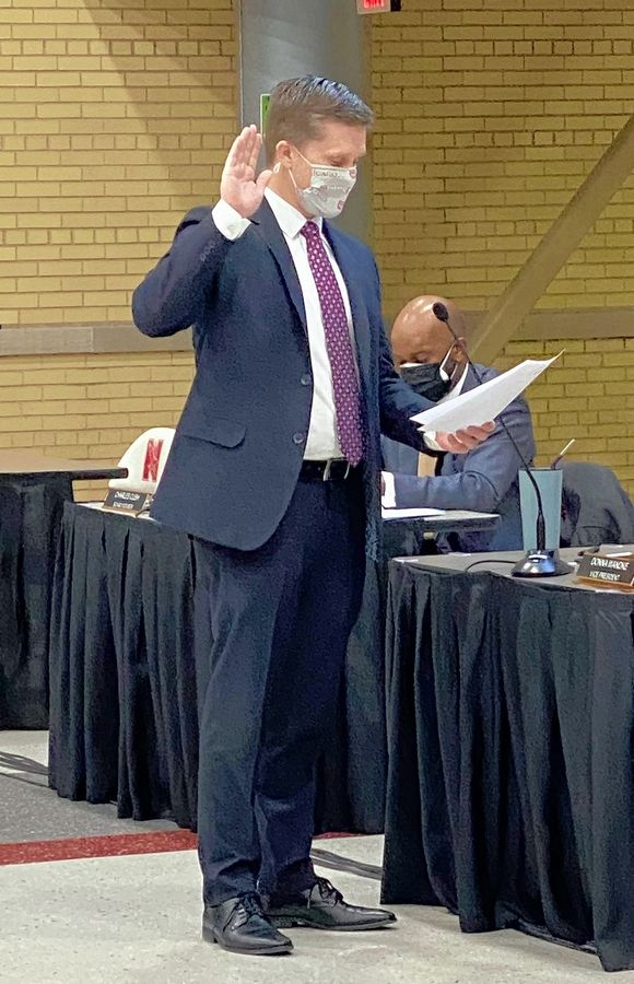 Naperville native Tony Casey, an attorney and father of four, was sworn in Monday to the Naperville Unit District 203 school board. He replaces Janet Yang Rohr, who resigned in January to assume a new position as state representative.