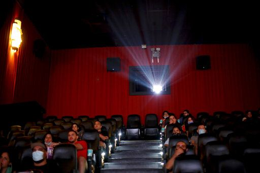 People watch a movie at a cinema after almost a year of theaters being closed due to the COVID-19 pandemic, in Buenos Aires, Argentina, Wednesday, March 3, 2021.