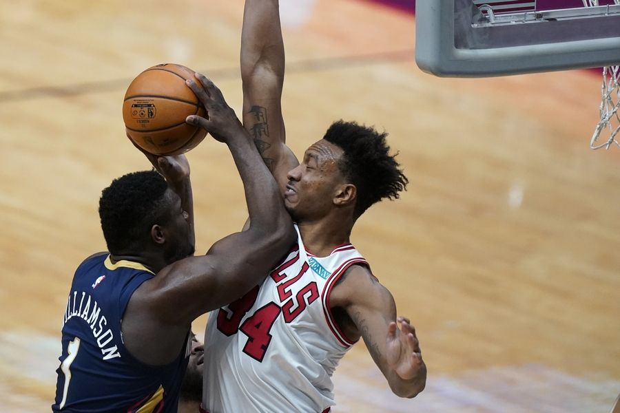 Pelicans forward Zion Williamson is impeded on his way to the basket by Bulls center Wendell Carter Jr. during Wednesday's game in New Orleans.