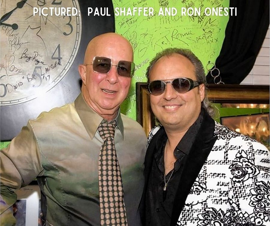 "Arcada Theatre owner Ron Onesti, right, wore this jacket when Paul Shaffer of ""Late Night with David Letterman"" fame brought a band of well-known musicians to perform in St. Charles."