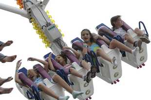 Kids scream with glee on a ride at Buffalo Grove Days. The fate of this year's festival is uncertain.