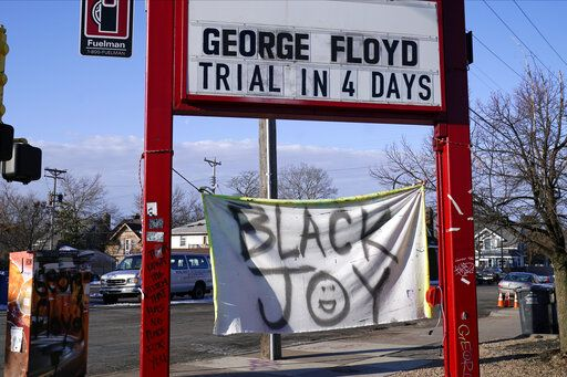 A trial countdown sign marks the days at George Floyd Square, March 4, 2021, in Minneapolis. Ten months after police officers brushed off George Floyd's moans for help on the street outside a south Minneapolis grocery, the square remains a makeshift memorial for Floyd who died at the hand of police making an arrest. The trial of former Minneapolis police officer Derek Chauvin will begin with jury selection on March 8.