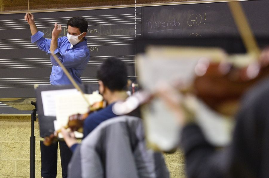 Elgin Youth Symphony Orchestra artistic director Matthew Sheppard rehearses with a group Sunday at Elgin Community College.