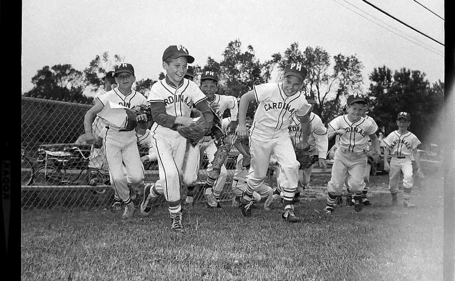 The Daily Herald Archive, Assignment # 1,065, Al Smith photo: Play ball was the call as 210 Prospect Heights Little Leaguers turned out for opening day ceremonies in May of 1965. The enthusiasm of the major league Cardinals unfortunately did not carry them to victory as they dropped the opening contest 1-0 to the White Sox.