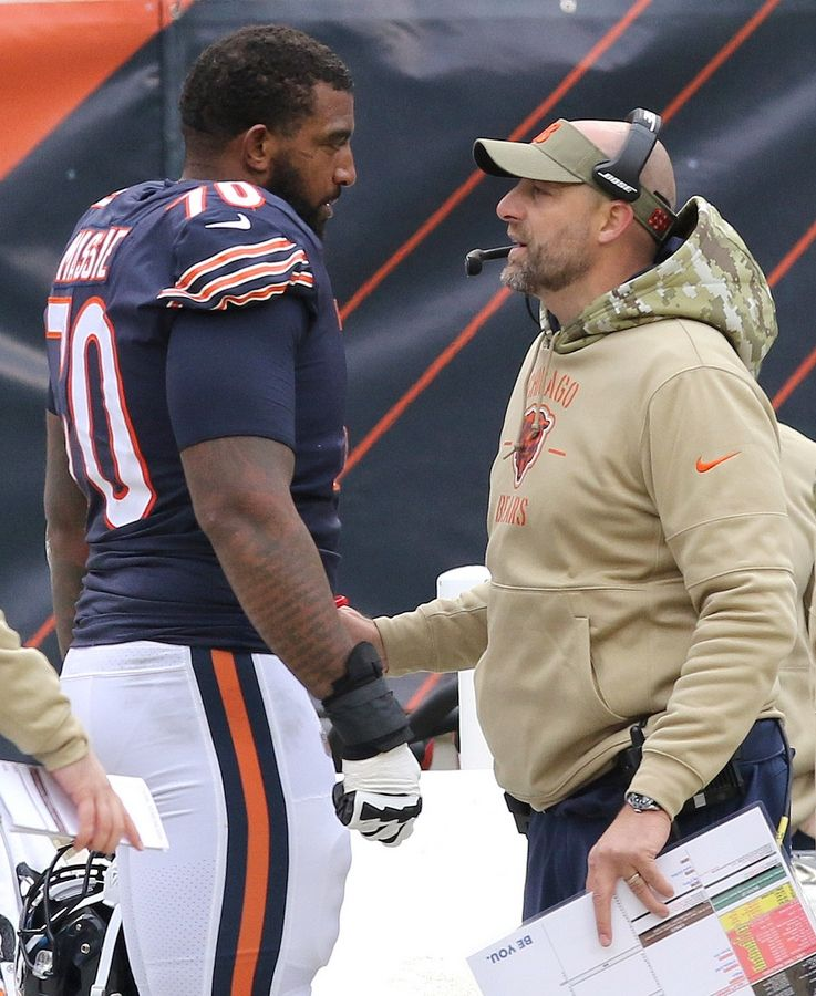 Bears head coach Matt Nagy talks to offensive lineman Bobby Massie during a 2019 game. The NFL Network reports the Bears will release Massie.