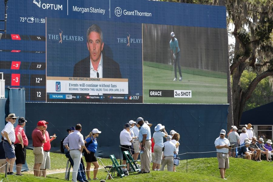 Jay Monahan is broadcast late morning of last year's first round that The Players Championship would continue without spectators. Several hours later, he shut down the tournament.