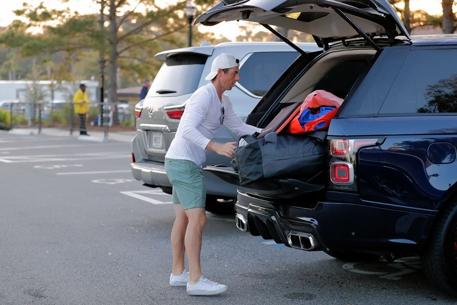 Rory McIlroy packs his vehicle March 13, 2020, after the PGA Tour canceled the rest of The Players Championship in Ponte Vedra Beach, Fla., due to the pandemic.