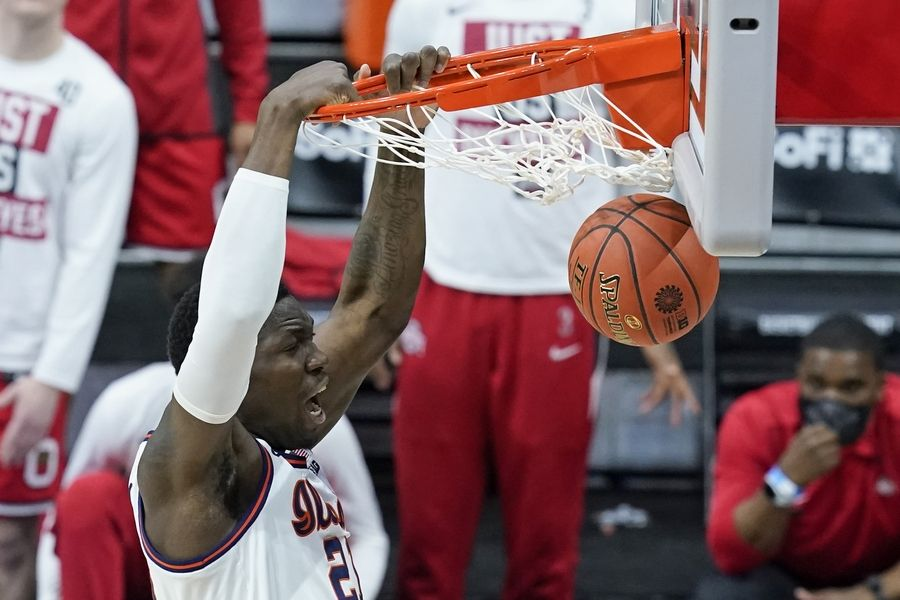 Illinois's Kofi Cockburn dunks during the first half of an NCAA college basketball game against Ohio State at the Big Ten Conference championship, Sunday, March 14, 2021, in Indianapolis.