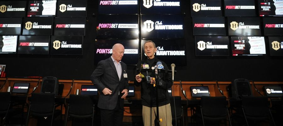 Prospect Heights Mayor Nick Helmer presents a key to Tim Carey, president and CEO of Hawthorne Race Course, during the opening of the new PointsBet Sportsbook at Club Hawthorne on Tuesday.