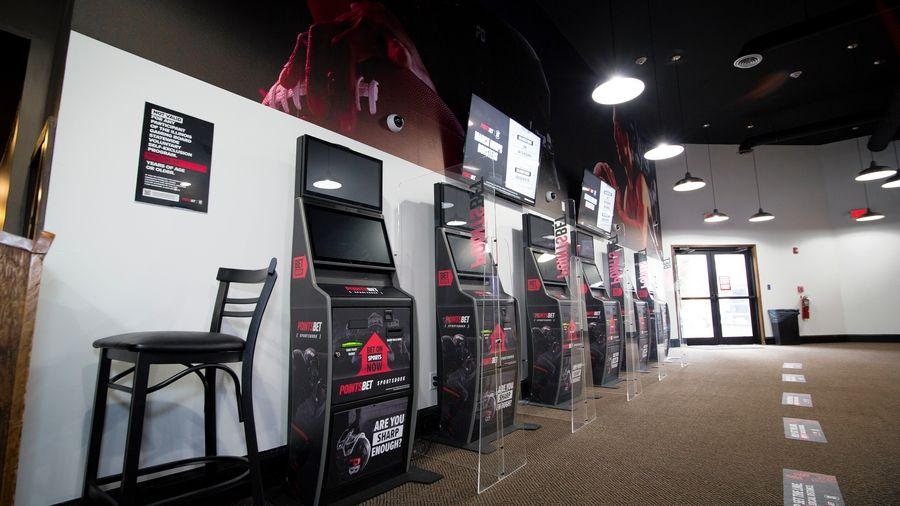 Sports bettors can wager at self service kiosks at the PointsBet Sportsbook at Club Hawthorne in Prospect Heights.