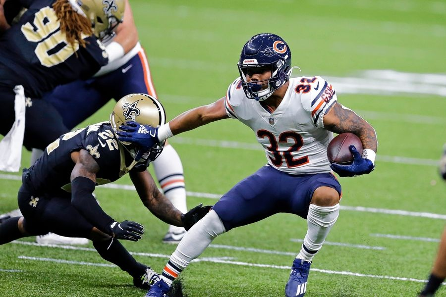 Bears running back David Montgomery (32) carries against New Orleans Saints free safety Chauncey Gardner-Johnson (22) in the first half of an NFL wild-card playoff football game in New Orleans, Sunday, Jan. 10, 2021.