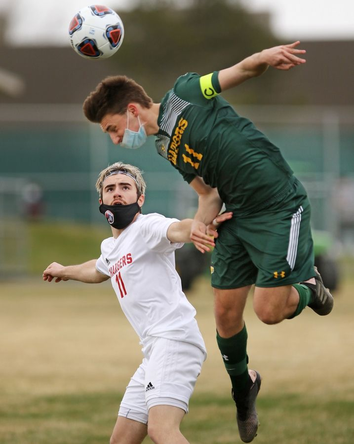 Crystal Lake South's Tyler Getzinger, right, jumps for the header as Dundee-Crown's Osvaldo Rodriguez defends during their boys soccer game on Tuesday, March 30, 2021 at Crystal Lake South High School in Crystal Lake.