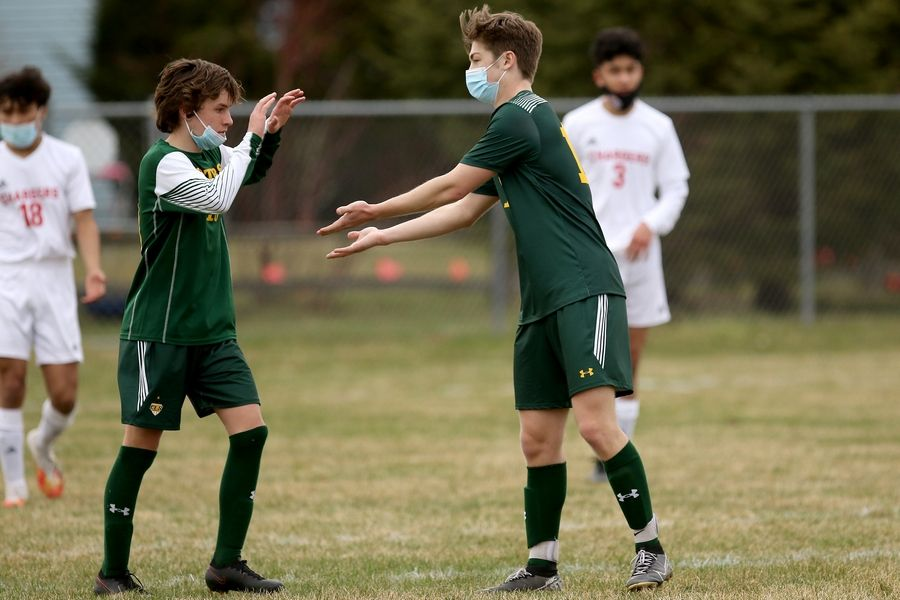 Crystal Lake South's Tom Coughlin, left, congratulates teammate Sam Bahnfleth, right, on Bahnfleth's goal against Dundee-Crown during their boys soccer game on Tuesday, March 30, 2021 at Crystal Lake South High School in Crystal Lake.