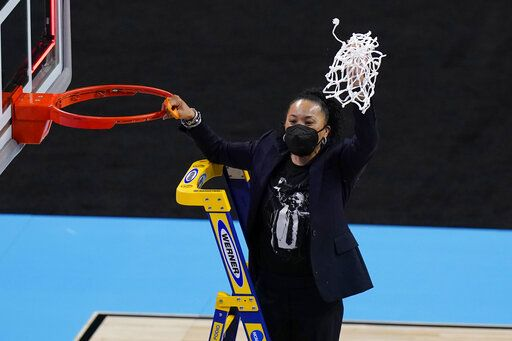 South Carolina head coach Dawn Stanley cuts down the net after the team's win over Texas in a college basketball game in the Elite Eight round of the women's NCAA tournament at the Alamodome in San Antonio, Tuesday, March 30, 2021.