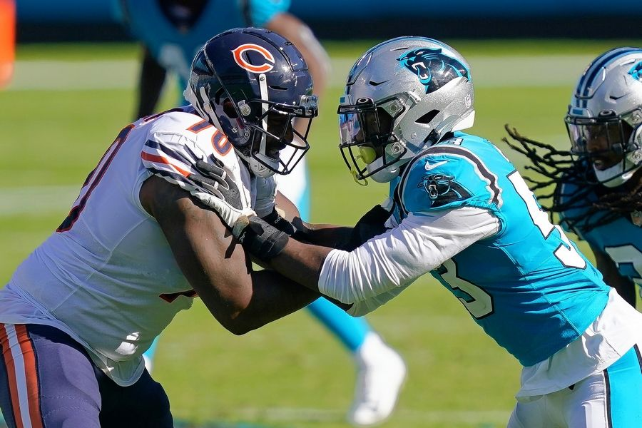Chicago Bears offensive tackle Bobby Massie, left, and Carolina Panthers defensive end Brian Burns face off during a 2020 game.