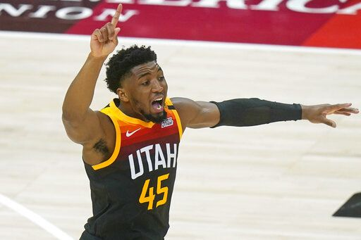 Utah Jazz guard Donovan Mitchell (45) directs his team in the first half during an NBA basketball game against the Chicago Bulls, Friday, April 2, 2021, in Salt Lake City.