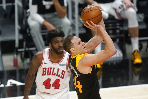 Utah Jazz forward Bojan Bogdanovic, right, shoots as Chicago Bulls forward Patrick Williams (44) looks on in the first half during an NBA basketball game Friday, April 2, 2021, in Salt Lake City.