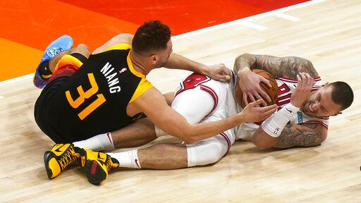 Chicago Bulls center Daniel Theis, right, and Utah Jazz forward Georges Niang (31) battle for the ball in the second half during an NBA basketball game Friday, April 2, 2021, in Salt Lake City.