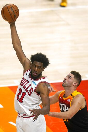 Utah Jazz forward Georges Niang, right, guards Chicago Bulls forward Thaddeus Young (21) in the second half during an NBA basketball game Friday, April 2, 2021, in Salt Lake City.