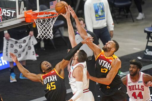 Utah Jazz's Rudy Gobert (27) and Donovan Mitchell (45) defend against Chicago Bulls center Nikola Vucevic, center, in the first half during an NBA basketball game Friday, April 2, 2021, in Salt Lake City.