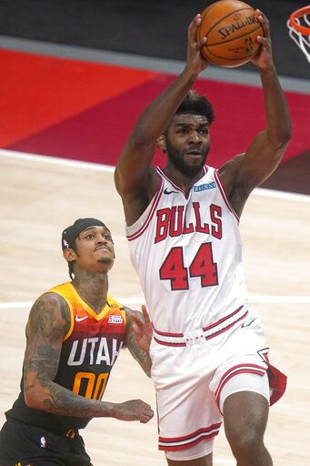 Chicago Bulls forward Patrick Williams (44) goes to the basket as Utah Jazz guard Jordan Clarkson (00) looks on in the first half during an NBA basketball game Friday, April 2, 2021, in Salt Lake City.