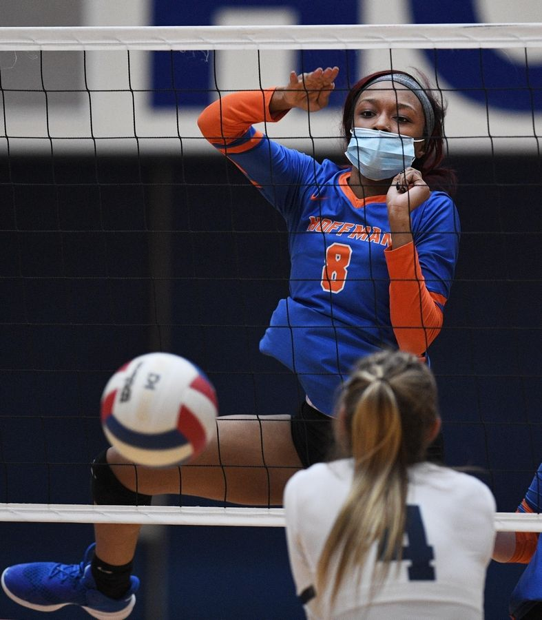 Hoffman Estates' Niyah McAllister slams a point against Conant's Danielle Smith in a girls volleyball match in Hoffman Estates Monday, April 5, 2021.