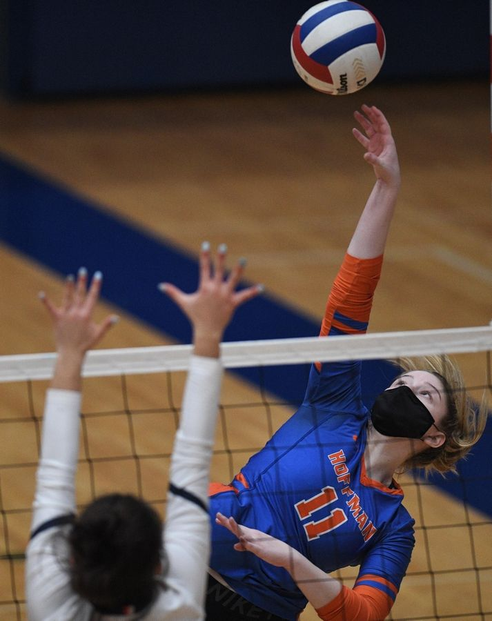 Hoffman Estates' Nora Rakoci reaches for her shot against Conant's Gianna Spekta in a girls volleyball match in Hoffman Estates Monday, April 5, 2021.
