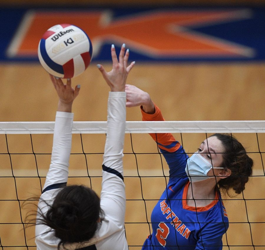 Hoffman Estates' Abby Major hits past Conant's Gianna Spekta in a girls volleyball match in Hoffman Estates Monday, April 5, 2021.