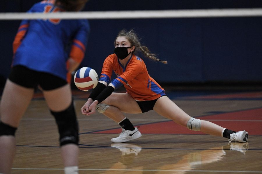 Hoffman Estates' Emma Essex slides to save a back row shot from Conant in a girls volleyball match in Hoffman Estates Monday, April 5, 2021.