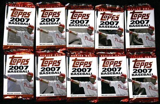 FILE - In this March 6, 2007 file photo, Topps baseball cards are seen in Boston.   Sports trading card company Topps is combining with a special purposes acquisition company in a deal valued at $1.3 billion and seeking a public listing. Topps Co. said Tuesday, April 6, 2021,  that it will join with Mudrick Capital Acquisition Corp., which will make a $250 million investment.
