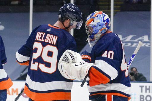 New York Islanders' Brock Nelson (29) celebrates with goaltender Semyon Varlamov (40) after an NHL hockey game against the Washington Capitals Tuesday, April 6, 2021, in Uniondale, N.Y. The Islanders won 1-0.