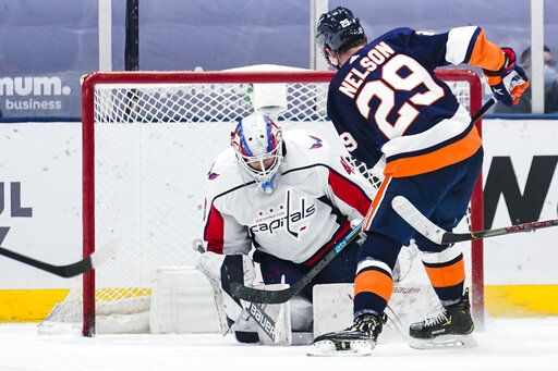 New York Islanders' Brock Nelson (29) shoots the puck past Washington Capitals goaltender Vitek Vanecek (41) during the third period of an NHL hockey game Tuesday, April 6, 2021, in Uniondale, N.Y. The Islanders won 1-0.
