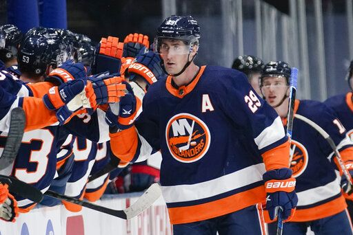 New York Islanders' Brock Nelson (29) celebrates with teammates after scoring a goal during the third period of an NHL hockey game against the Washington Capitals Tuesday, April 6, 2021, in Uniondale, N.Y. The Islanders won 1-0.