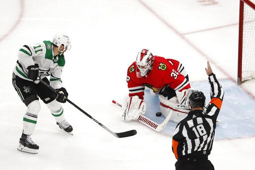 Dallas Stars center Andrew Cogliano (11) scores a short handed goal past Chicago Blackhawks goaltender Kevin Lankinen (32) during the third period of an NHL hockey game Tuesday, April 6, 2021, in Chicago.