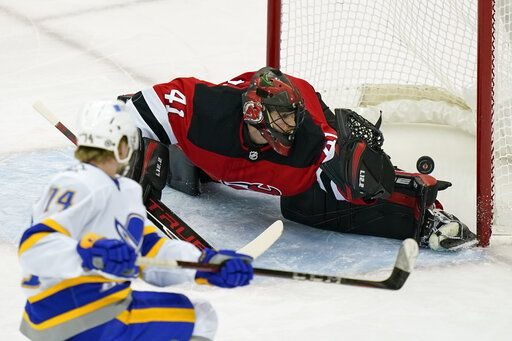 Buffalo Sabres center Rasmus Asplund (74) scores on New Jersey Devils goaltender Scott Wedgewood (41) during the first period of an NHL hockey game Tuesday, April 6, 2021, in Newark, N.J.