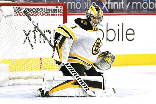 Boston Bruins goaltender Jeremy Swayman makes pad save on a shot during the first period of an NHL hockey game against the Philadelphia Flyers, Tuesday, April 6, 2021, in Philadelphia.