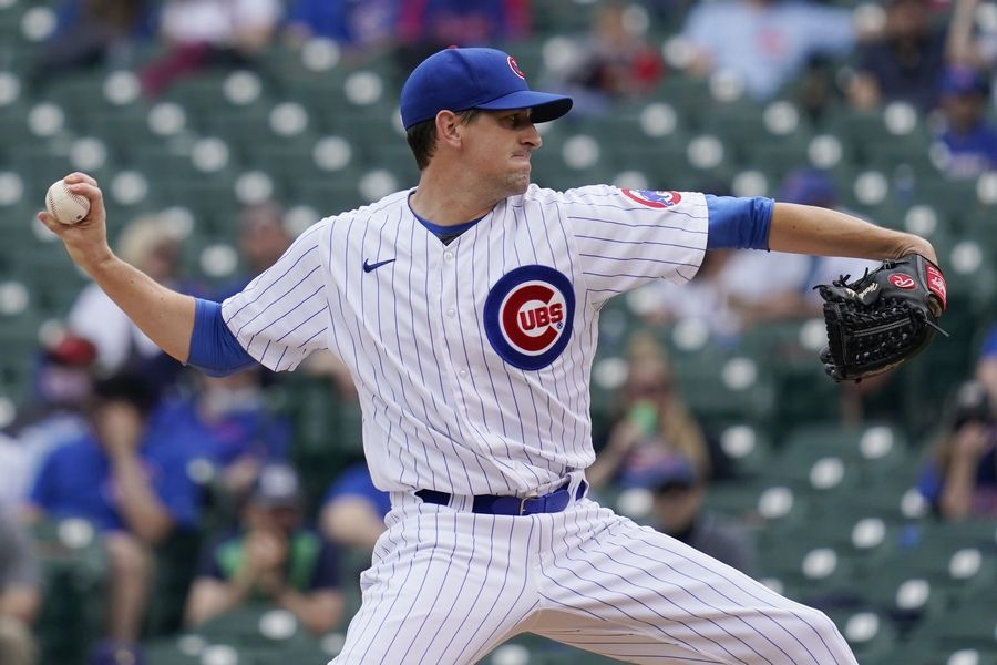 Chicago Cubs starting pitcher Kyle Hendricks throws against the Milwaukee Brewers during the first inning of a baseball game in Chicago, Wednesday, April 7, 2021.
