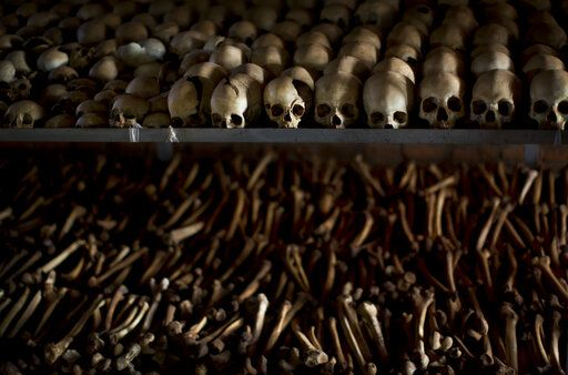 "FILE - In this Friday, April 4, 2014 file photo, the skulls and bones of some of those who were slaughtered as they sought refuge inside the church, are laid out on shelves in an underground vault as a memorial to the thousands who were killed in and around the Catholic church during the 1994 genocide in Nyamata, Rwanda. France's role before and during 1994's Rwandan genocide was a ""monumental failure"" that the country must face, the lead author of a sweeping report commissioned by President Emmanuel Macron said, as the country is about to open its archives from this period for the first time to the broader public."